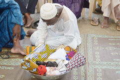 Endows africa. Abidjan, Cote d'Ivoire- February 26,2015: does a traditional wedding ceremony in Abidjan. A full bowl full of cloths, shoes and scarves to Stock Photography