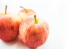 Endroit d'Apple le troisième sur un fond blanc image libre de droits