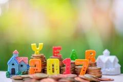 endroit de nombre des 2017 textes sur des pièces de monnaie avec la maison Images libres de droits