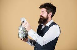 Endroit s?r pour garder l'argent Comptable personnel Homme d'affaires avec son ?pargne du dollar Richesse et bien-?tre Homme barb photo stock