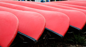 Ends of Red Canoes Royalty Free Stock Image