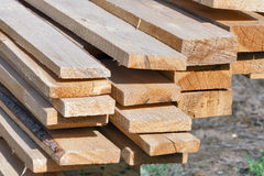 Ends of rough pine boards in the outdoor stack Royalty Free Stock Photography