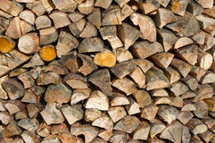 Ends of stacked firewood. Ends of cut and stacked firewood Stock Photo