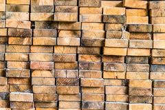 Ends of wooden beams stacked on each other stock photos
