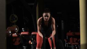Endurance. Muscular woman exercising with rope in crossfit gym stock video