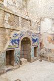The Enduring Artwork and Design of Herculaneum. Beautiful mosaic adorns a wall Royalty Free Stock Image