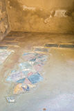 The Enduring Artwork and Design of Herculaneum. A glimpse of once a beautiful tiled floor Royalty Free Stock Photography