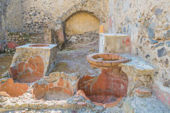 The Enduring Artwork and Design of Herculaneum. Pots and stoves in an ancient kitchen Stock Image