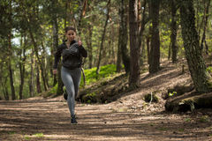 Enduring runner preparing for marathon Royalty Free Stock Images
