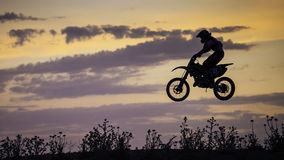 Enduro Bike jumping at sunset Royalty Free Stock Photography