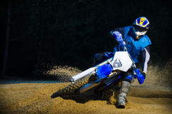 Enduro bike rider. On action. Turn on sand terrain royalty free stock images