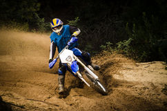 Enduro bike rider. On action. Turn on sand terrain stock photos