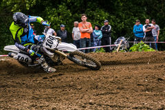 Enduro bike rider accelerating in dirt track. TransCarpathian regional Motocross Championship Stock Images