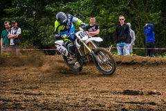 Enduro bike rider accelerating in dirt track. TransCarpathian regional Motocross Championship Royalty Free Stock Photos
