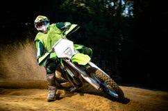 Enduro bike rider. On action. Turn on sand terrain stock photo