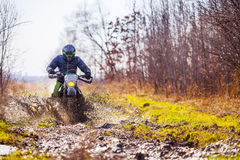 Enduro bike rider on dirt track. With deep mud royalty free stock image