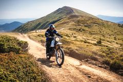 Enduro Bikers Crossing Road In Carpathian Mountains. Royalty Free Stock Photography