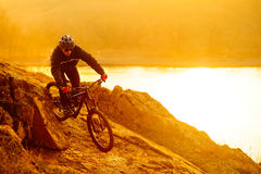 Enduro Cyclist Riding the Mountain Bike Down Beautiful Rocky Trail. Extreme Sport Concept. Space for Text. Royalty Free Stock Image