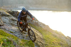 Enduro Cyclist Riding the Mountain Bike Down Beautiful Rocky Trail. Extreme Sport Concept. Space for Text. Royalty Free Stock Images