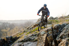 Enduro Cyclist Riding the Mountain Bike Down Beautiful Rocky Trail. Extreme Sport Concept. Space for Text. Royalty Free Stock Photo