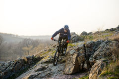 Enduro Cyclist Riding the Mountain Bike Down Beautiful Rocky Trail. Extreme Sport Concept. Space for Text. Royalty Free Stock Photos