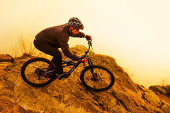 Enduro Cyclist Riding the Mountain Bike on the Rock. Extreme Sport Concept. Space for Text. Royalty Free Stock Photography