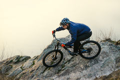 Enduro Cyclist Riding the Mountain Bike on the Rock. Extreme Sport Concept. Space for Text. Royalty Free Stock Photo