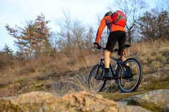 Enduro Cyclist Riding the Mountain Bike on the Rocky Trail. Extreme Sport Concept. Space for Text. Royalty Free Stock Images