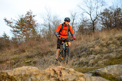 Enduro Cyclist Riding the Mountain Bike on the Rocky Trail. Extreme Sport Concept. Space for Text. Royalty Free Stock Photo