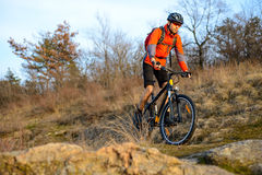 Enduro Cyclist Riding the Mountain Bike on the Rocky Trail. Extreme Sport Concept. Space for Text. Royalty Free Stock Photos