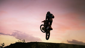Enduro jump against red sunset sky Royalty Free Stock Photo