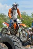 Enduro moto cross rider on a track Stock Photo