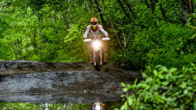 Enduro moto in the mud with a big splash Stock Image