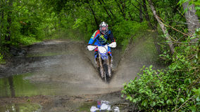 Enduro moto in the mud with a big splash Royalty Free Stock Photography