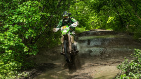 Enduro moto in the mud with a big splash Royalty Free Stock Image