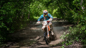 Enduro moto in the mud with a big splash Royalty Free Stock Images