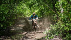 Enduro moto in the mud with a big splash Royalty Free Stock Photos