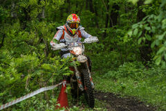 Enduro moto in the mud with a big splash. Khabarovsk, Russia - may 30. 2016 : unknown rider in action on stage Enduro Khabarovsk . Motorcyclists ride in the mud royalty free stock image