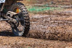 Enduro,motocross in the mud,Details of flying debris during an acceleration royalty free stock image