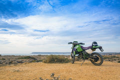 Enduro motorbike on the rock in Sagres, Portugal Royalty Free Stock Photography