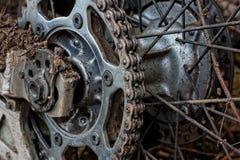 Enduro motorbike wheel and chain. Royalty Free Stock Image