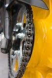 Enduro motorbike wheel and chain Stock Photo
