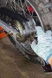 Enduro motorbike wheel and chain. Closeup shot Royalty Free Stock Image