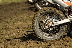 Enduro motorbike wheel. Muddy rear wheel of enduro motorbike royalty free stock image