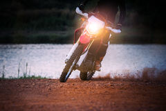Enduro motorcycle biker slide moving on dirt field Royalty Free Stock Photo