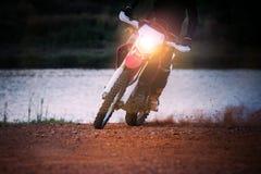 Enduro motorcycle biker slide moving on dirt field Royalty Free Stock Photo