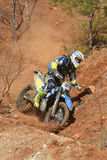 Enduro motorcycles descend from the steep slope on the mountain. Khabarovsk , Russia - may 10, 2015 : Enduro motorcycles descend from the steep slope on the Stock Photos