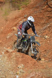 Enduro motorcycles descend from the steep slope on the mountain. Khabarovsk , Russia - may 10, 2015 : Enduro motorcycles descend from the steep slope on the Stock Photo
