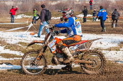 Enduro racer. With mud on motorbike royalty free stock images
