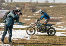 Enduro racer. Photographer takes a picture to enduro racer stock image